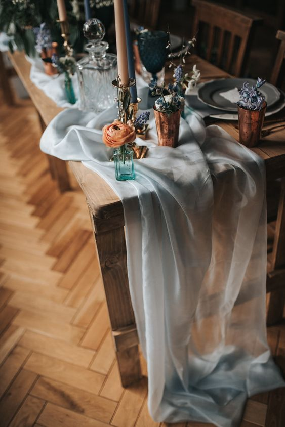 a sheer light blue airy table runner will give a slight touch of color and chic to the table