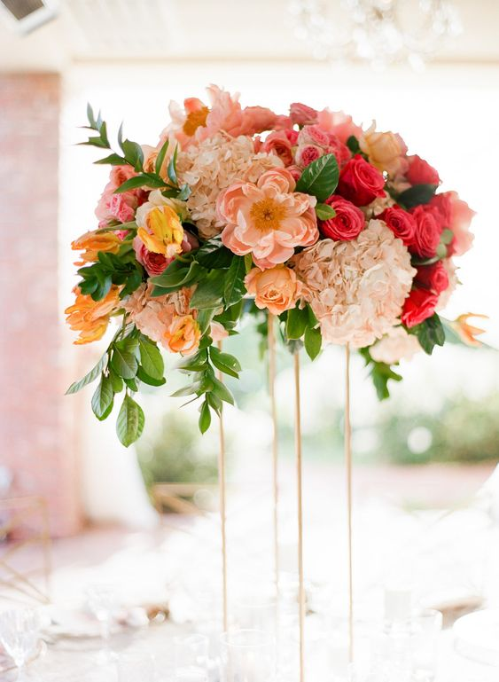 a tall wedding centerpiece in fuchsia, blush, white and yellow plus greenery is a bright idea for spring