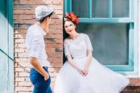 a white midi A-line wedding dress with an illusion neckline, short sleeves, red shoes and a floral headpiece