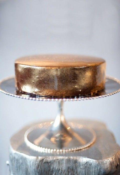an elegant gold leaf one tier wedding cake is amazing for a modern or minimalist wedding
