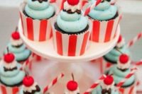 chocolate cupcakes with mint icing and little cherries in striped cupcake liners