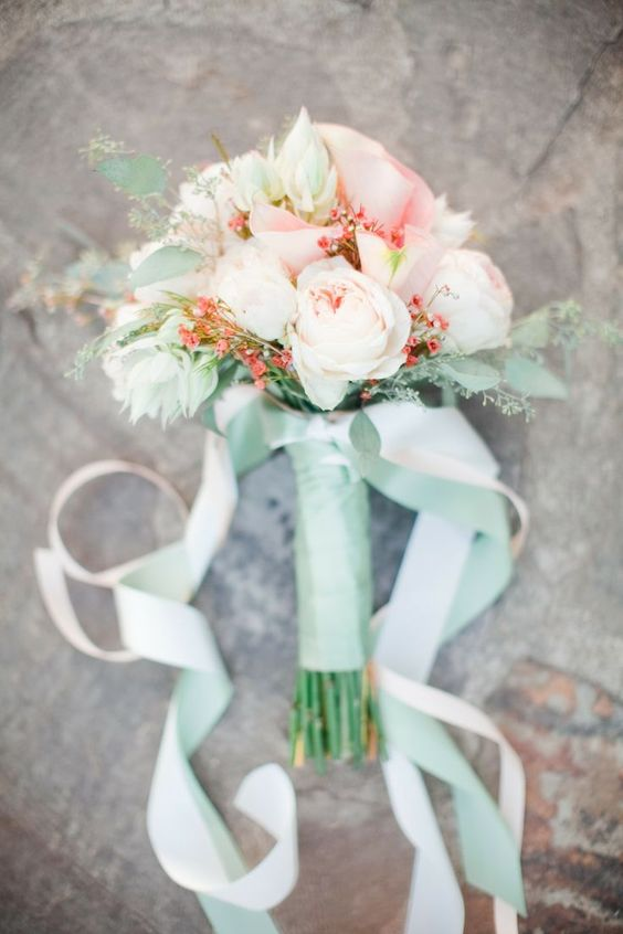 coral and white blooms, greenery in a mint wrap for a cool and bold wedding bouquet