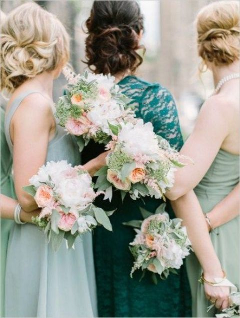 mismatching mint bridesmaid dresses, coral, white and mint bouquets for all the gals