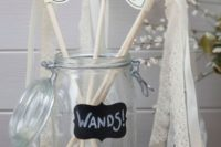 wedding wands with lace ribbons, mini bells and letters are a fun and cool idea for a wedding exit