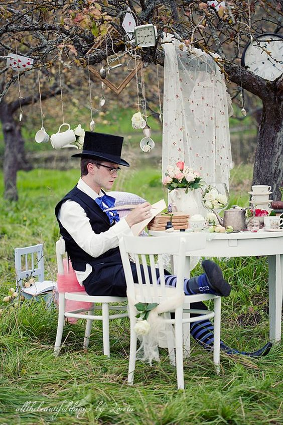 a cool alice in wonderland groom's outfit