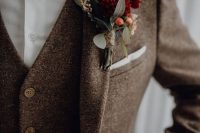 a brown tweed three-piece suit, a white button down, a burgundy velvet bow tie and a matching boutonniere for a stylish fall or winter wedding