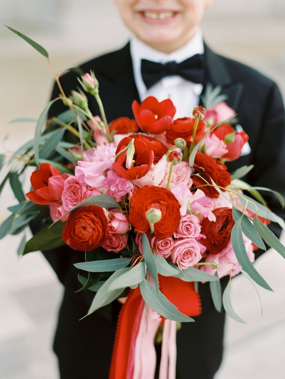 a colorful wedding bouquet in red and pink plus foliage is a creative and bold idea to rock
