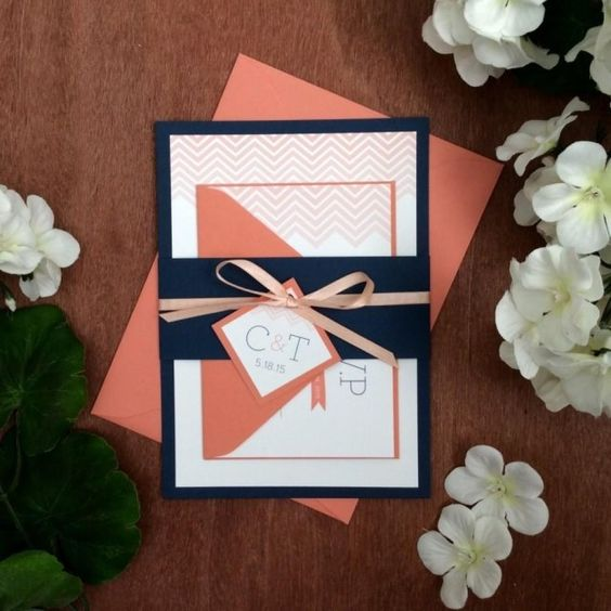 a coral and navy wedding invitation suite with prints and bows for a bold and whimsy wedding