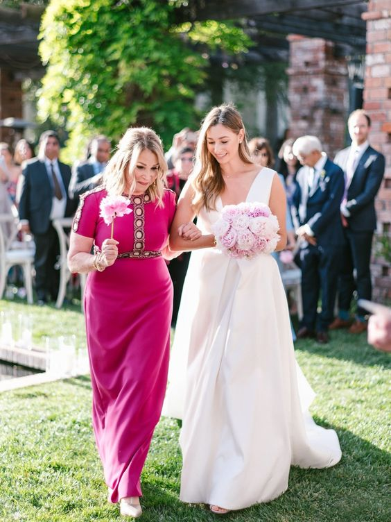 a fuchsia colored maxi dress with embellishments and embroidery is a stunning idea for a summer wedding
