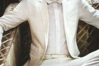 a gorgeous elegant look with a creamy suit, a white shirt, a cremay bow tie and brown shoes