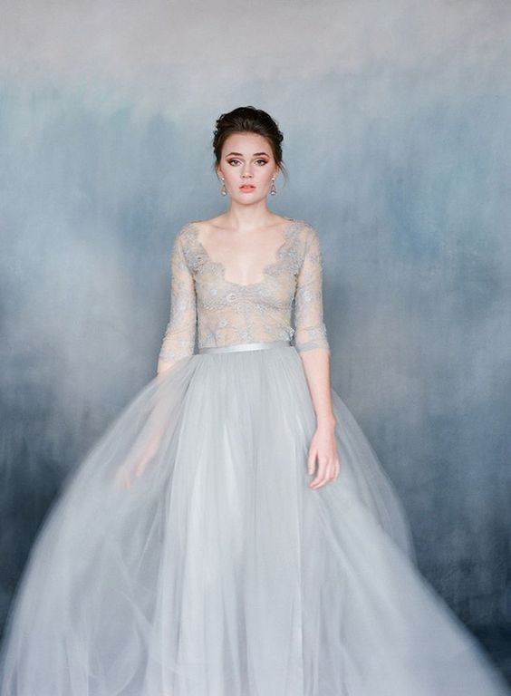 a gorgeous wedding ballgown in dove grey with a lace bodice with long sleeves and a full skirt for a refined look
