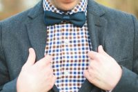 a graphite grey suit, a colorful plaid shirt, a navy bow tie for a bold fall groom's look