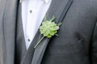 a grey three-piece tux with a white shirt, an emerald bow tie and a succulent boutonniere compose a modern refined look
