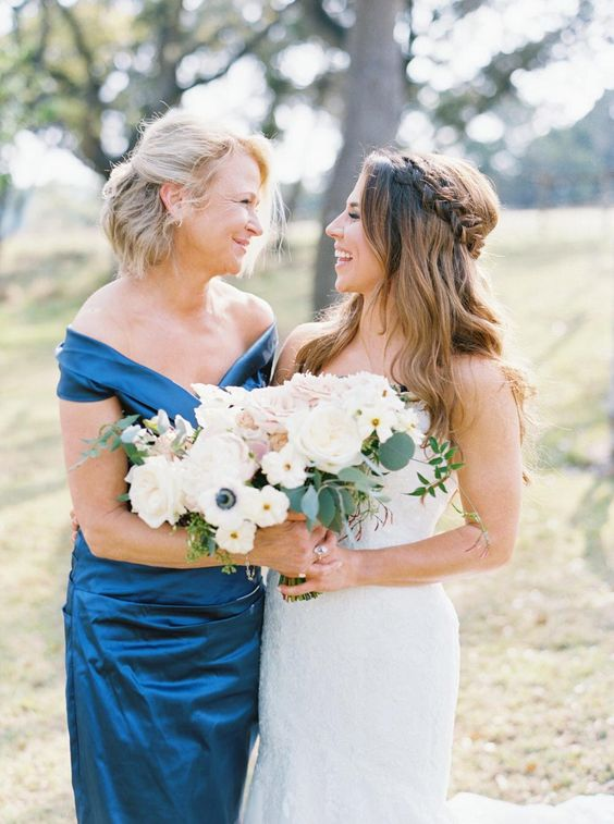 a luxurious navy off the shoulder draped midi dress is a stylish and refined option for a mother of the bride