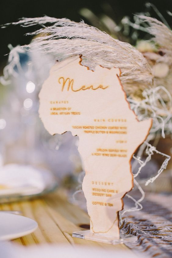a menu shaped as the continent of Africa is a very creative idea to decorate a safari tablescape
