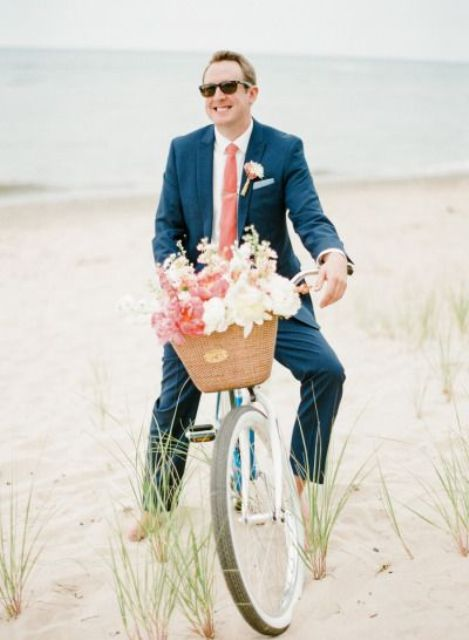 a navy suit, a white shirt and coral tie for an ultimate beach groom's look