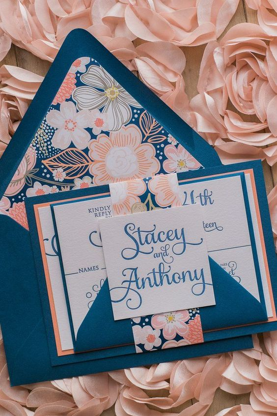 a romantic wedding invitation suite with floral prints shows off a bright color pair that is super pretty