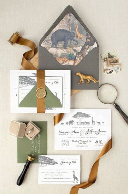 a safari-themed wedding invitation suite with animal lining, green items and a gold ribbon is a cool idea