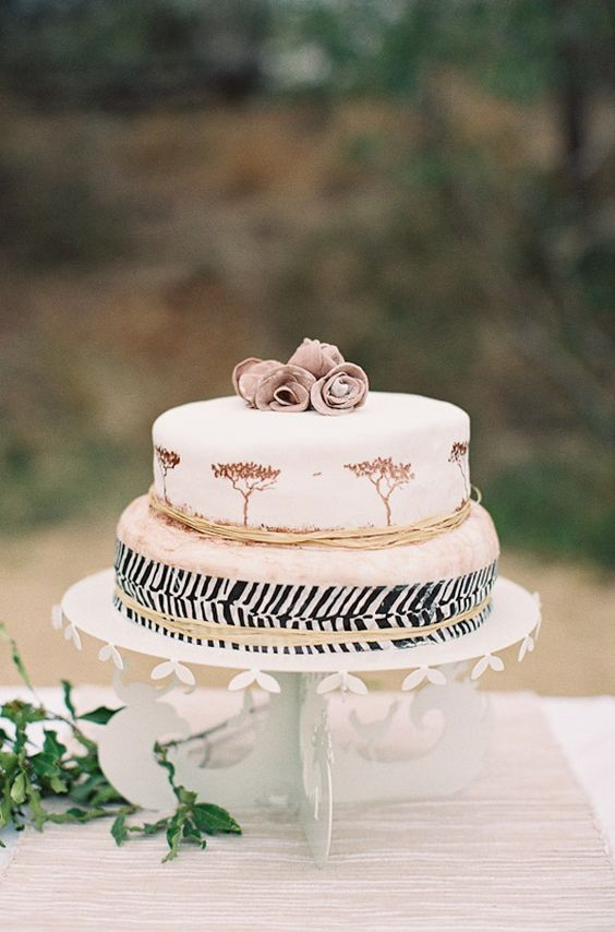 a safari wedding cake with painted trees and striped tier with twine plus sugar blooms