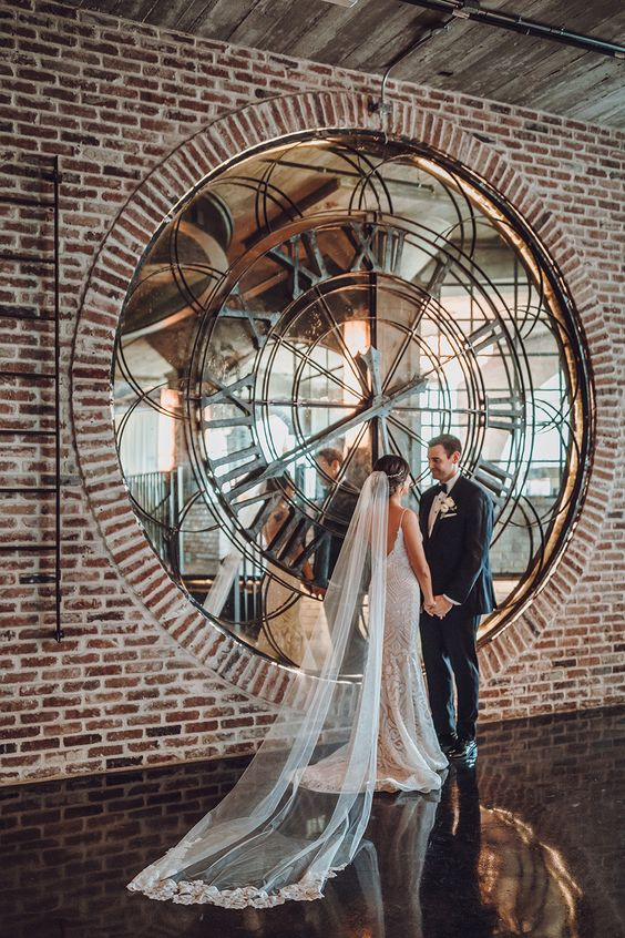 a unique wedding backdrop - an oversized mirror clock is a cool idea for a modern or industrial wedding