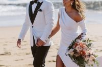 a white tux with black lapels, a black bow tie for a formal and refined groom's look