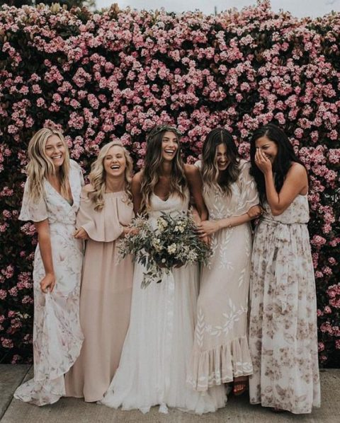 bridesmaids in mismatched floral maxi dresses and in blush ones for a beautiful spring or summer wedding