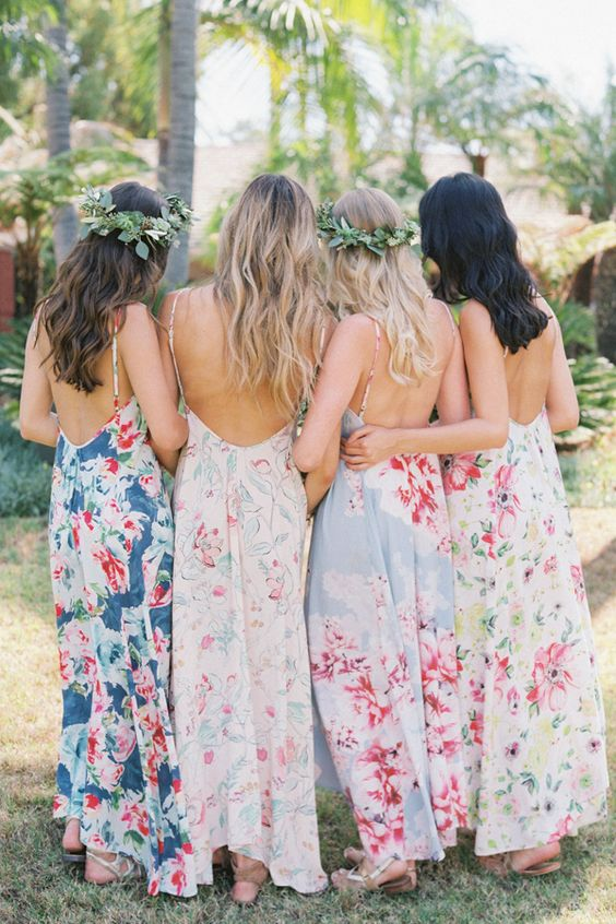 bright floral print mismatched maxi dresses with open backs and spaghetti straps for a bright summer wedding