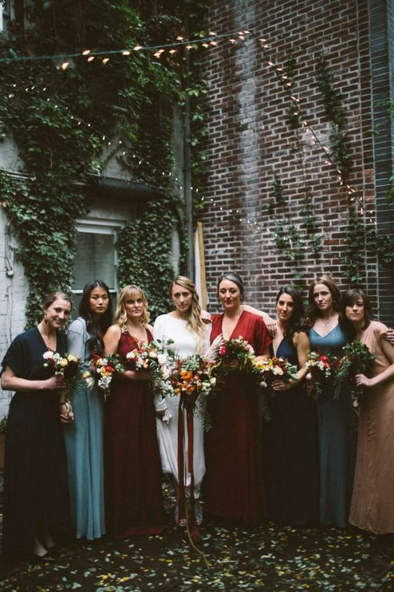 bright mismatched boho bridesmaids' dresses in blue, navy, red, burgundy and light blue