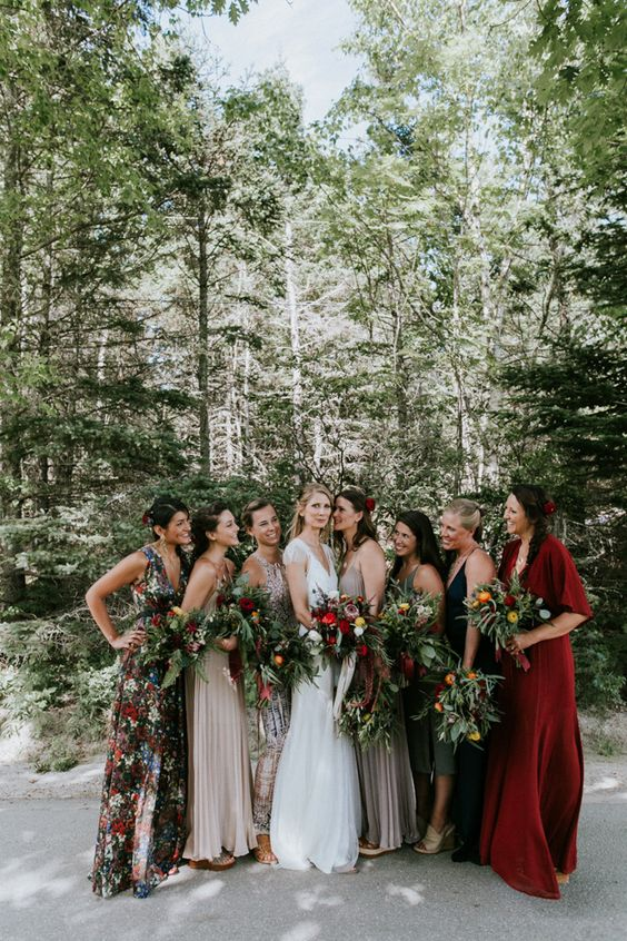 chic mismatched bridesmaids' maxi dresses with a floral print, in bold red, neutrals and dark shades