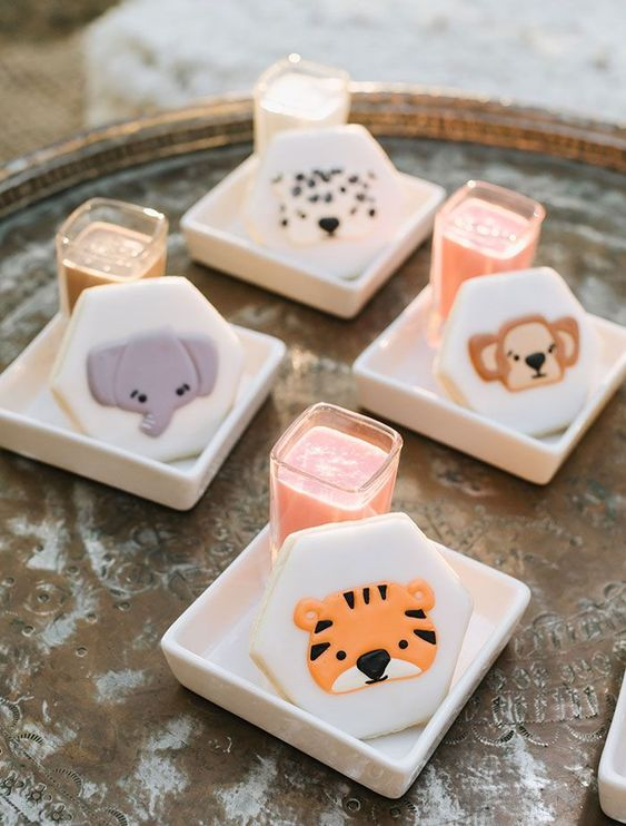 funny colorful animal cookies for desserts at a safari wedding