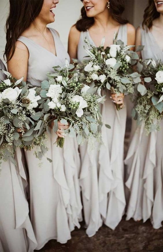 grey sleeveless bridesmaid maxi dresses with V-necklines and ruffle tiered skirts for a modern grey wedding