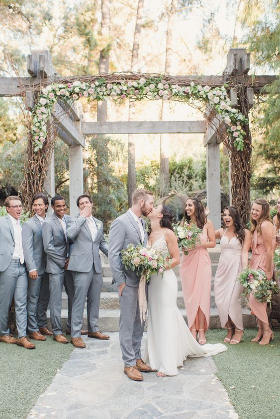 grey suits for the groom and groomsmen and blush ties and white shirts for a chic modern combo