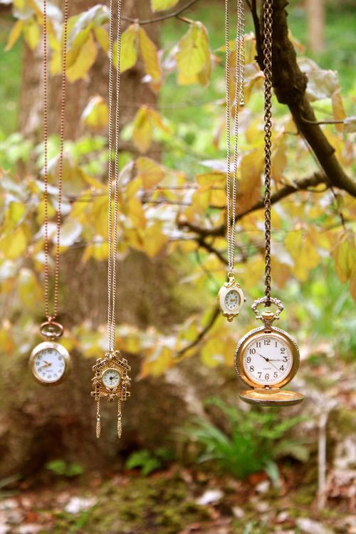 hanging wedding decor with lots of vintage pocket watches is amazing for a whimsy Alice in Wonderland wedding