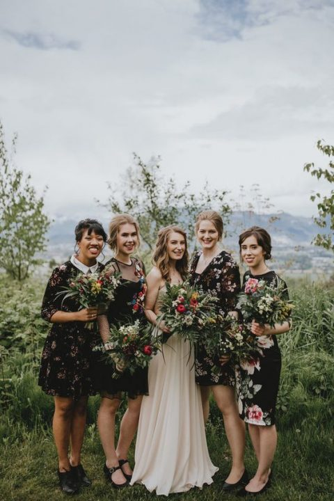 mismatched black floral knee dresses for a bit of edge at your boho chic wedding
