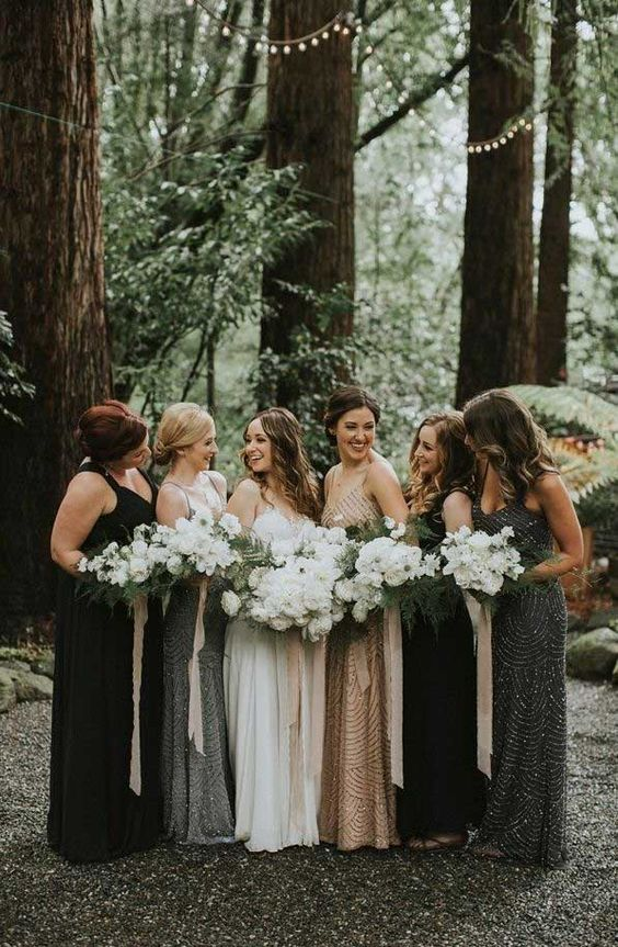 mismatched black, tan, grey bridesmaid dresses with and without embellishments for a woodland wedding