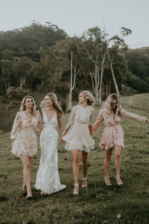 mismatched blush and white short bridesmaid dresses with various prints for a summer wedding