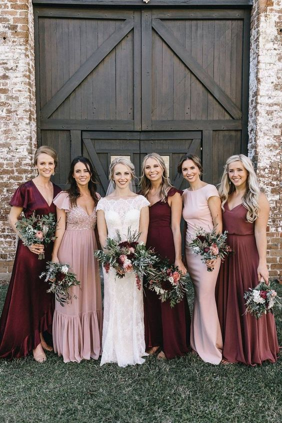mismatched blush, burgundy maxi bridesmaid dresses with various designs and detailing for a fall wedding