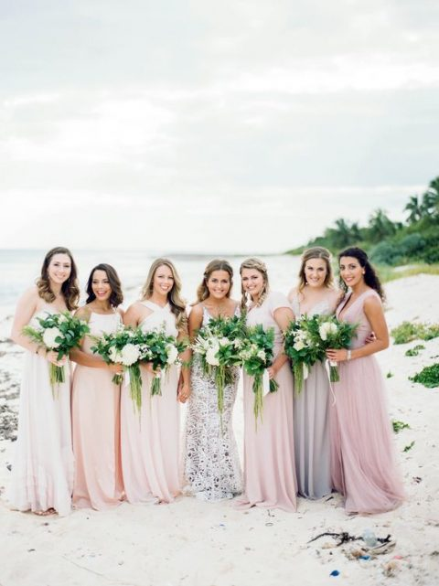 mismatched blush, lilac and pink maxi bridesmaid dresses for a bright or pastel beach or tropical wedding