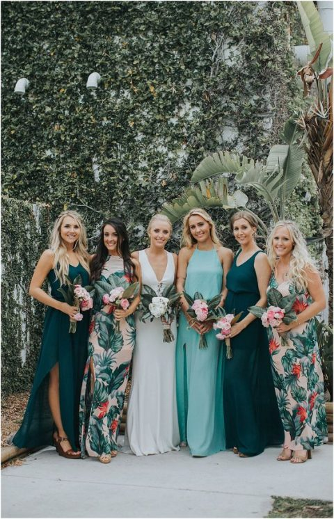 mismatched bridesmaid maxi dresses – with floral prints, in dark green and light blue with different necklines