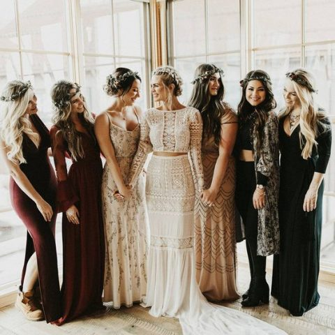 mismatched bridesmaids' looks in green, black, neutrals and burgundy for a boho chic fall wedding