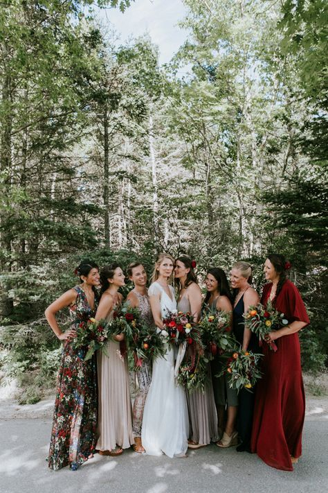 mismatched bridesmaids' dresses in green, grey, red and with floral prints to show off bridesmaids' style