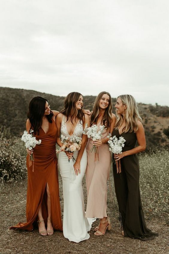 mismatched fall-colored and blush bridesmaid dresses and tan shoes for a chic fall wedding