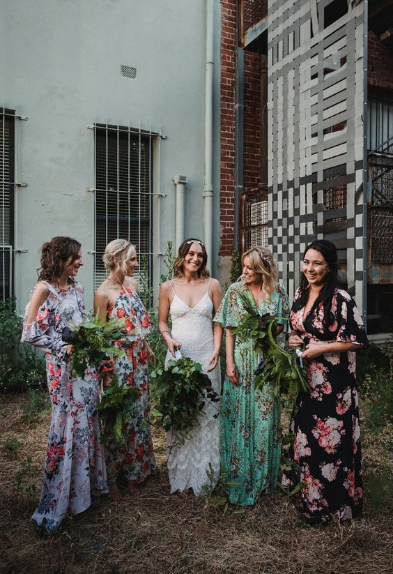 mismatched floral bridesmaids' dresses in green, lavender, black and white with bold floral prints