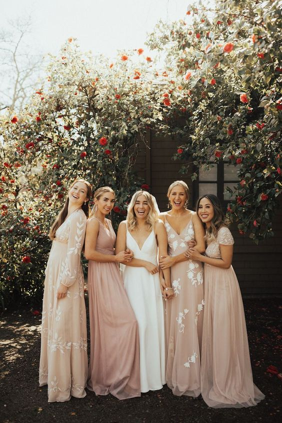 mismatched neutral and blush bridesmaid dresses with lace appliques for a romantic modern wedding