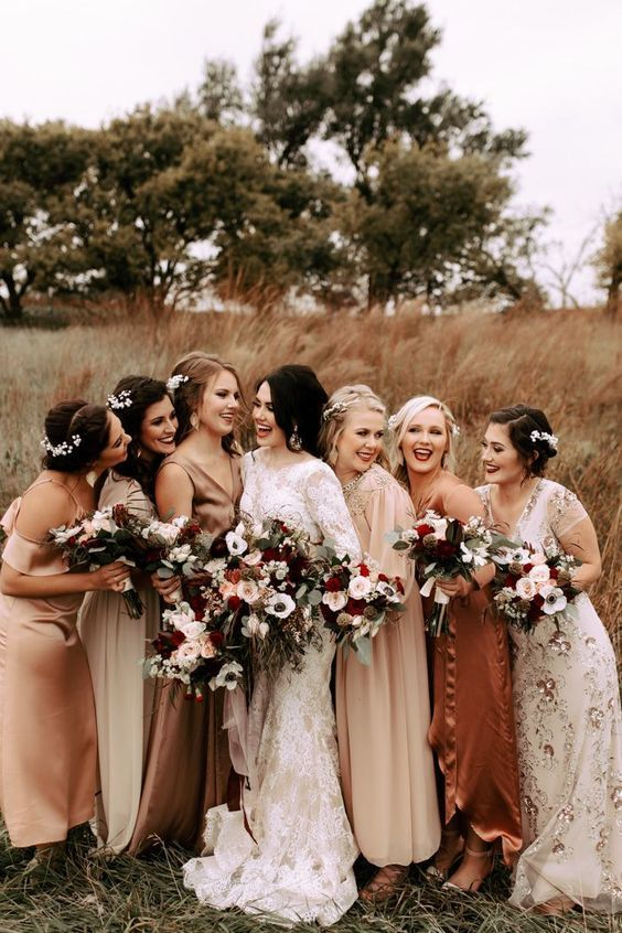 mismatched neutral and muted color bridesmaid dresses of midi and maxi lengths and with various designs and prints