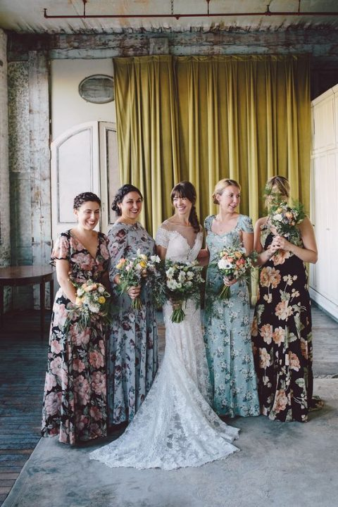 mismatching floral maxi bridesmaid dresses in various colors for a summer wedding