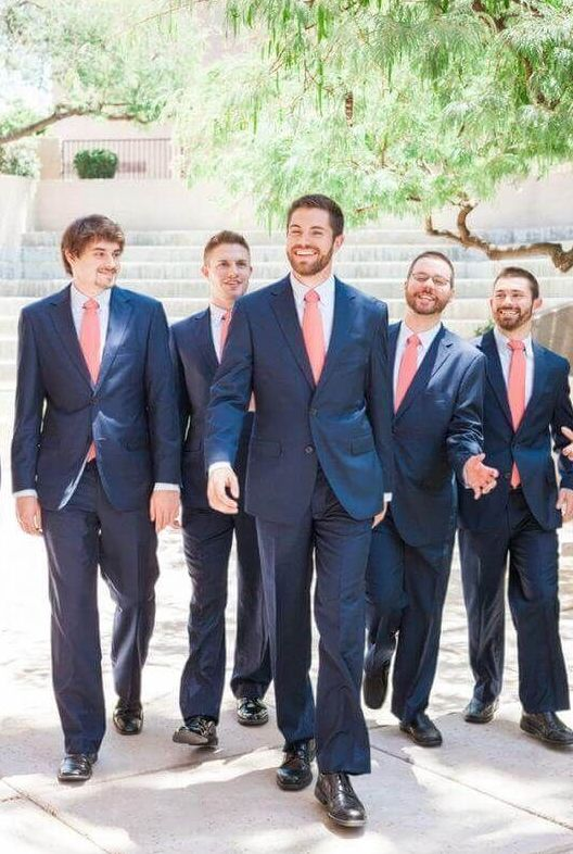 navy suits and coral pink ties for bright and fun groom and groomsmen attire with much color