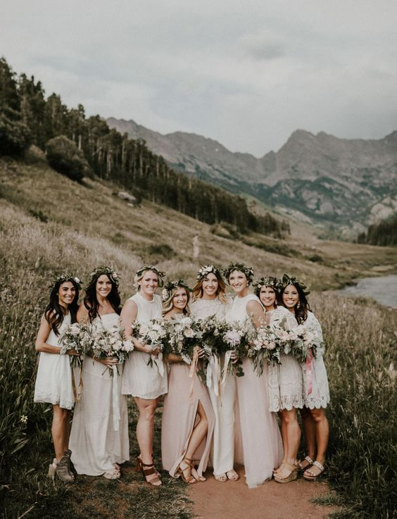 white lace short mismatched bridesmaids' dresses and various shoes for a cool neutral boho wedding