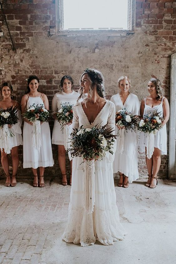 white mismatched bridesmaid dresses with a lace edge, tassels and fringe for a neutral summer wedding