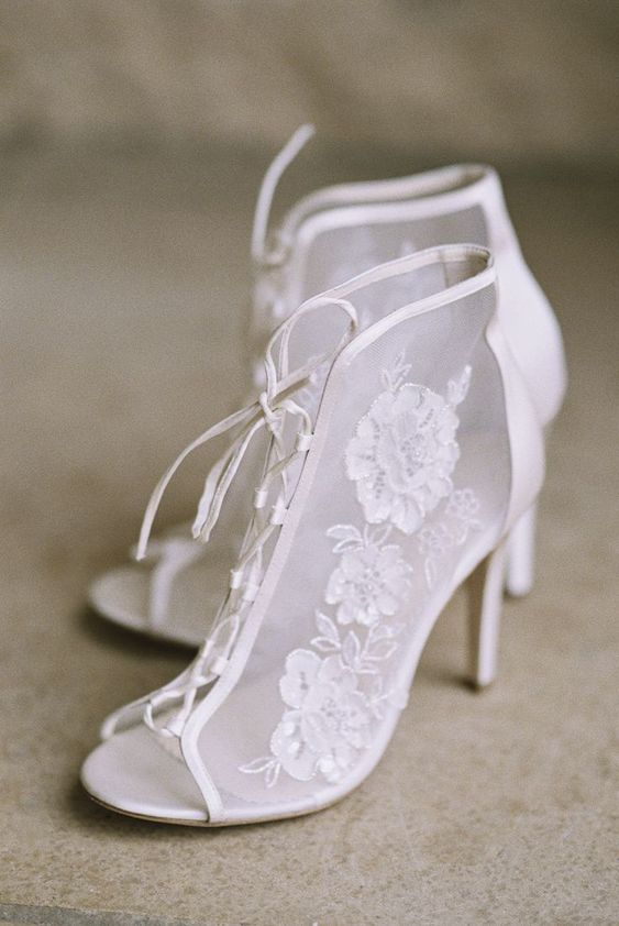 Victorian Era inspired white lace peep toe wedding booties with lacing up for a fashionable statement